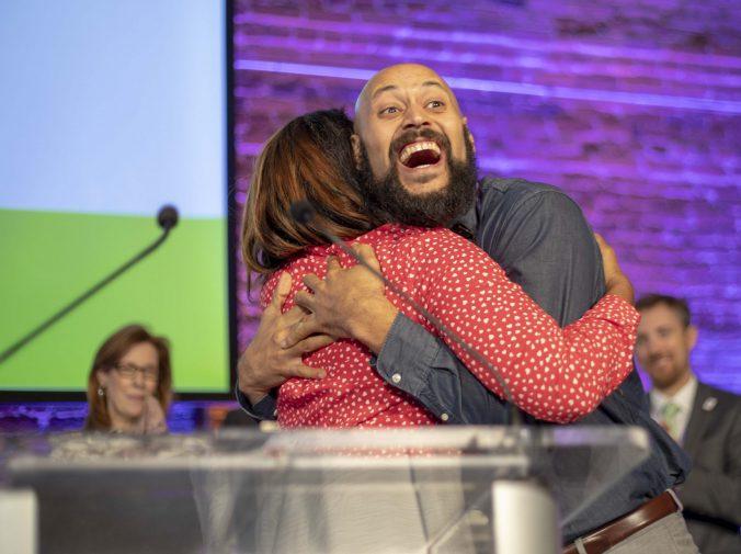 Justin Minott hugging Jes Averhart at awards ceremony