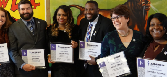 Award recipients standing together with certificates